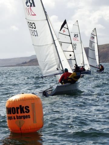 Fleet of boats starting a race